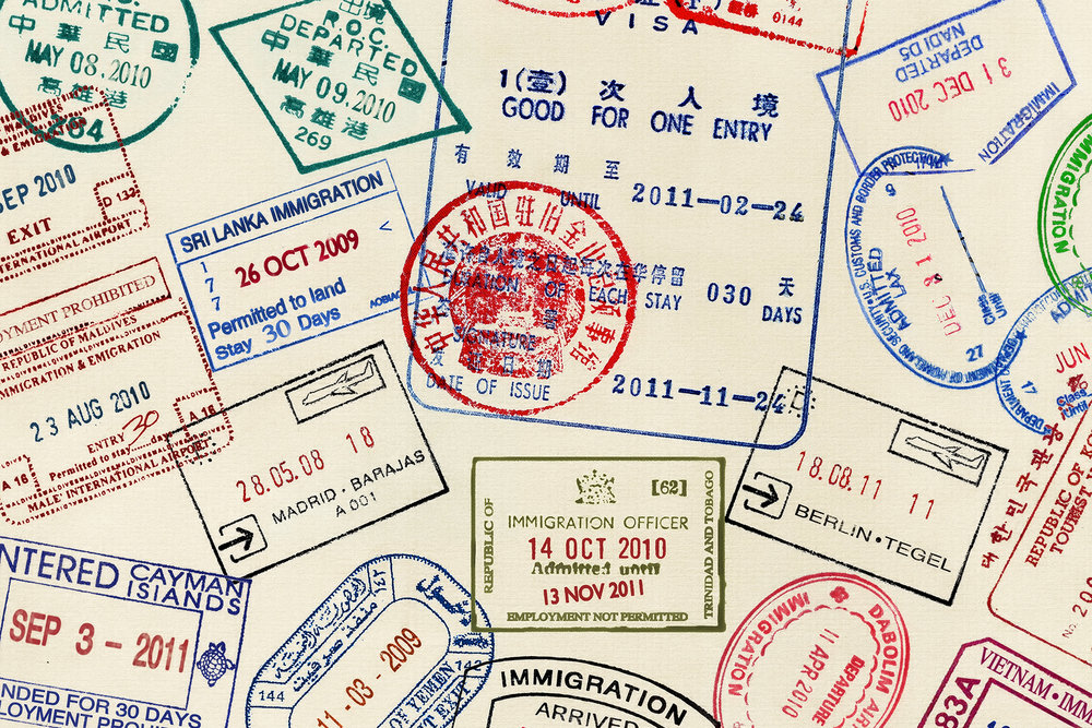 litany of passport stamps from Spain, China, Maldives, Iran, and many other countries.
