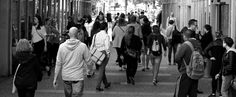 black and white pic of people walking