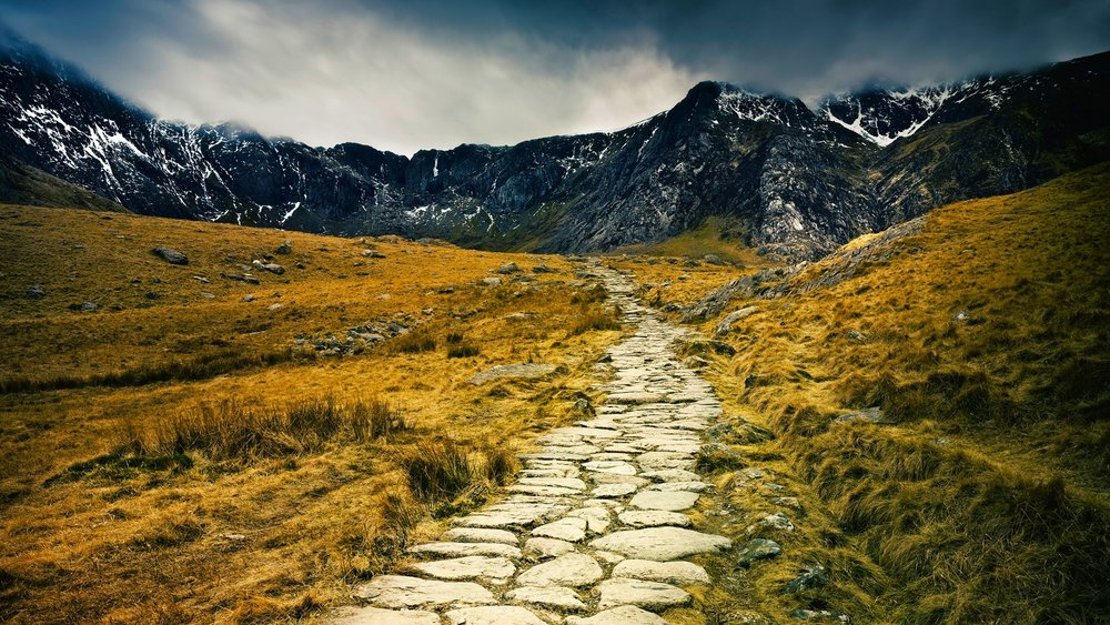 stone pathway wallpaper with mountains in the background