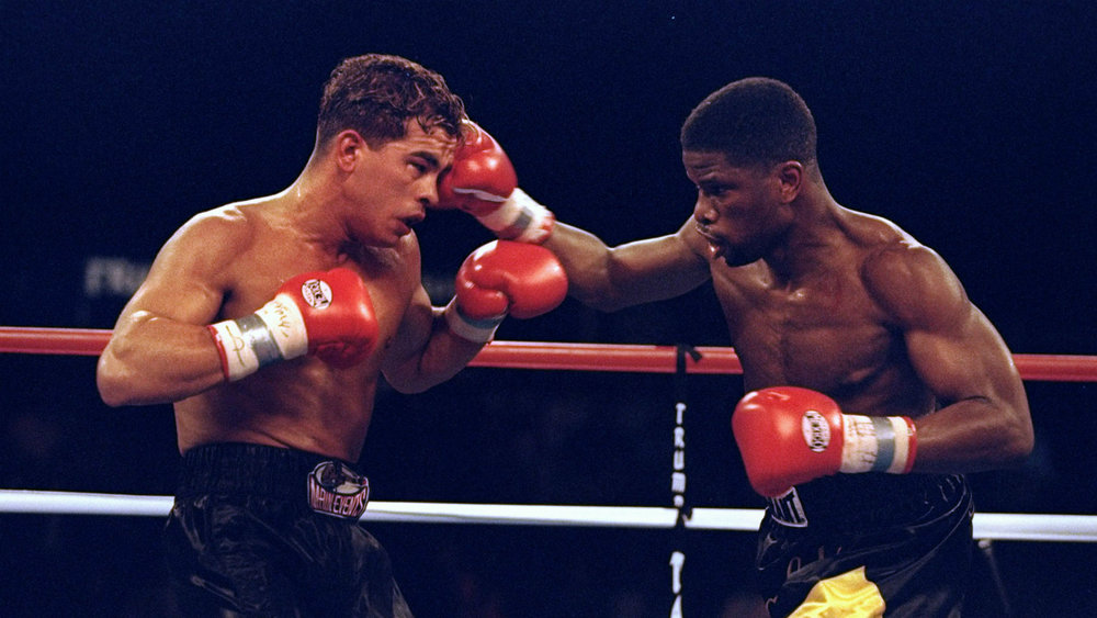 boxers square off against one another, one white and one black