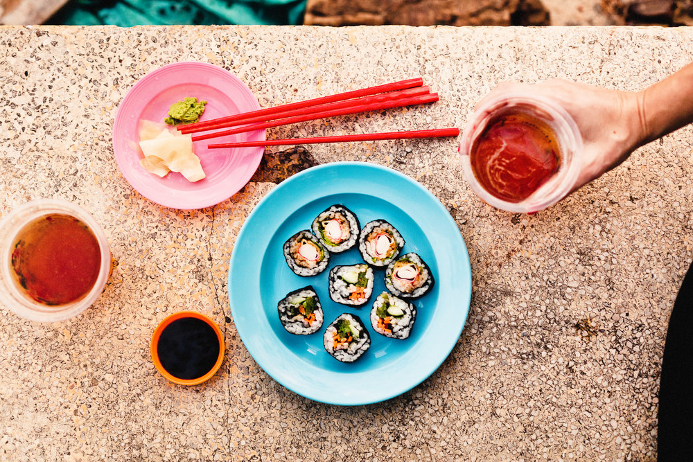 "Sushi rolls and hand crafted beer from the restaurant  ""Flowers home brew and sushi""  has a food truck down by the river."