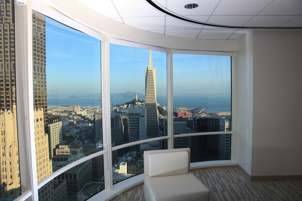 The view of the Transamerica Pyramid and the San Francisco Bay from inside an office at One Sansome Street.