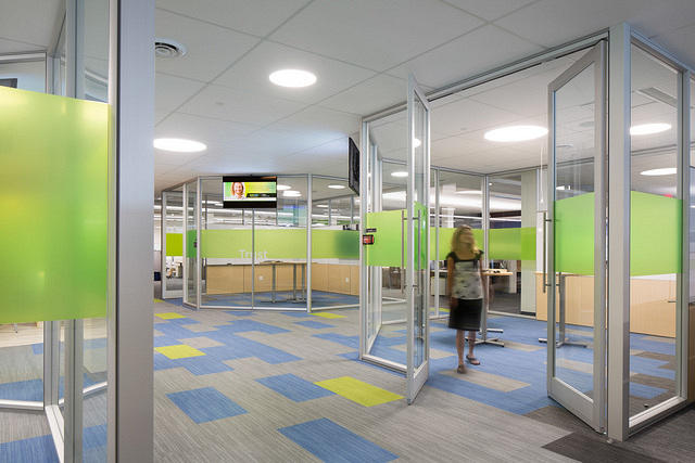 ... Redesigned To Accommodate Several Rapidly Expanding Departments. Angled  Full Height Glass And Clerestory Walls With Pivot Doors ...