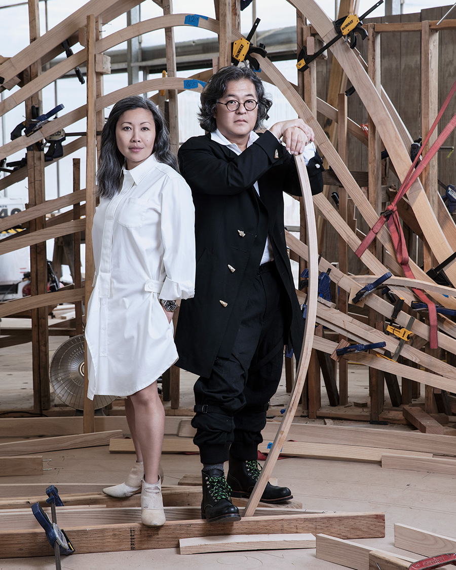 Susan Chang, left, and Joey Shimoda stand in front of a structural component of their update to Steelcase's Mart showroom. Courtesy Marta Elena Vassilakis