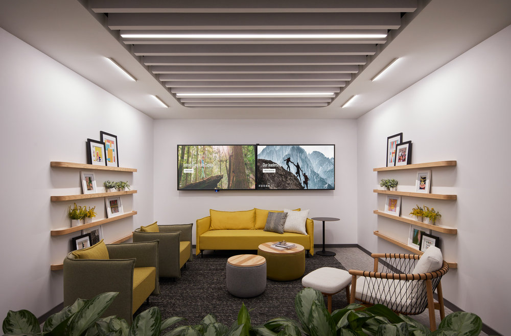 This cozy meeting space we created for a confidential client in Chicago is emblematic of multiple facets of hygge, including warm undertones, natural textures, comfortable seating, and spaces that bring people together.