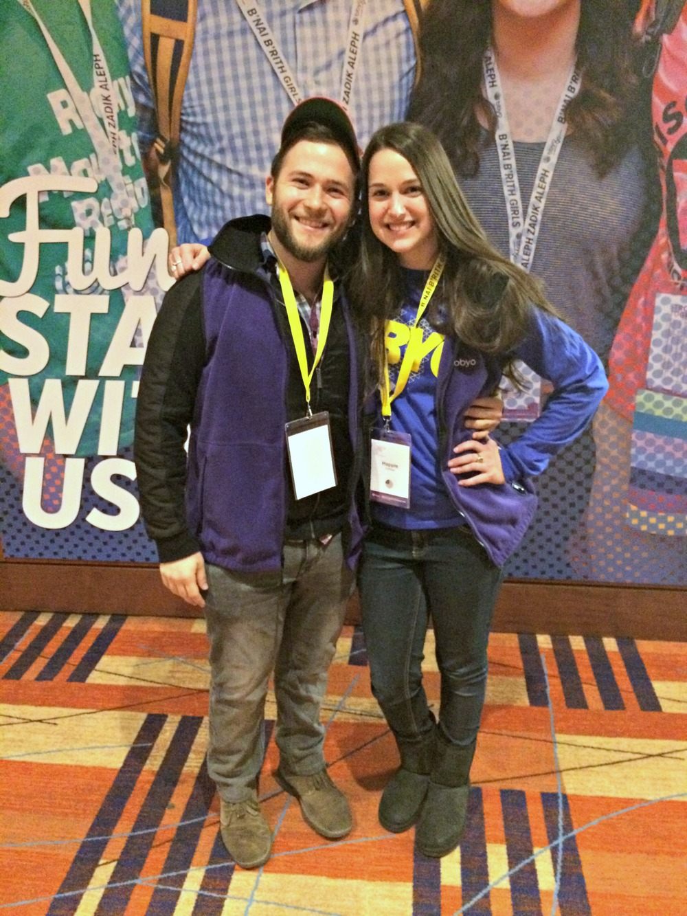 Songleaders Eric Hunker and Happie Hoffman sporting the purple staff vests. Have a question? Find anyone wearing them!