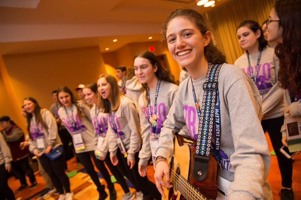 B'nai B'rith Girl teen song leader enjoying programs with friends. Photo by Mike Kandel Photography.
