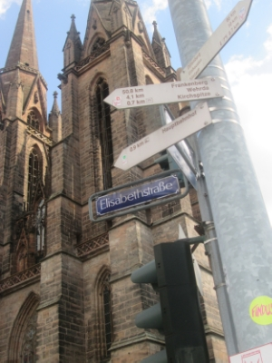Elisabethkirche behind street signs on Elisabethstraße