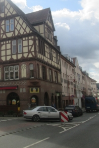 A more contemporary street in Marburg flanked by a half-timbered building