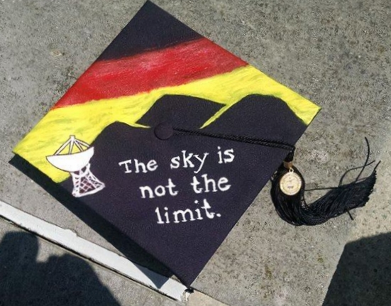 My mortarboard from my graduation from Dickinson. A nod to Germany with a German-flag-inspired sunset behind a mountainous backdrop for the Effelsberg Telescope.
