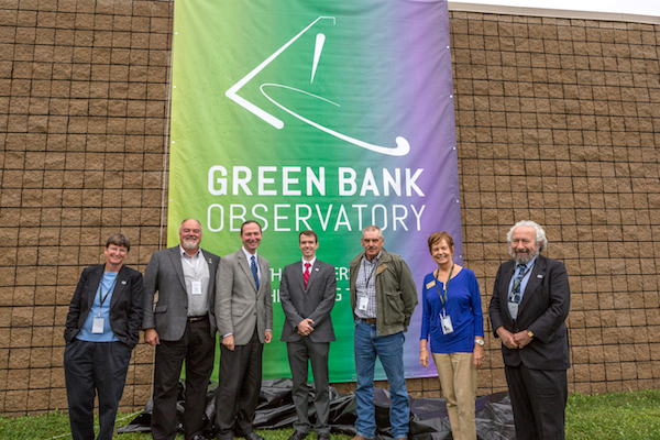 New Green Bank Observatory logo with (from left to right) Karen O'Neil, GBO director; Mike Holstine, GBO Business Manager; J. T. Jurkowski, Legislative Assistant for Senator Capito (R-WV); Geoff Hempelmann, Legislative Assistant for Congressman Jenkins (R-WV); Dave McLaughlin, Pocahontas County Commissioner; Peggy Hawse, Regional Coordinator for Senator Manchin (D-WV); Ethan Schrier, President and CEP of Associated Universities, Inc.  mage owned by Green Bank Observatory.