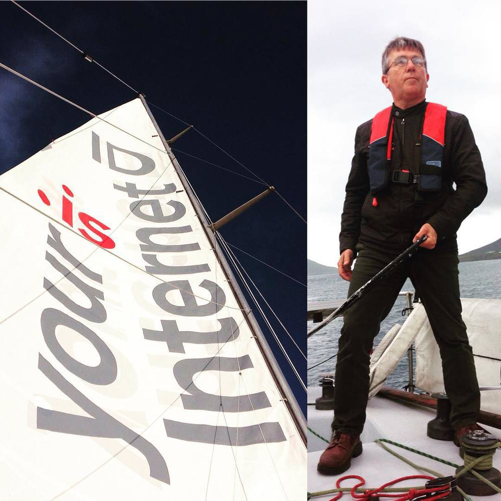 Jens driving Messenger (right) and Messengers sail with the .is logo and our partnership slogan (left)