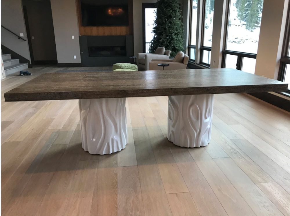 My go-to woodworker and I designed a series of custom furniture pieces for the home, including this cerused-oak-top dining table with modern, lacquered MDF bases carved to look like tree trunks. Adam Hodgdon of  Denver Woodworks  expertly executed my vision. The result is a fun and whimsical nod to the outdoors.