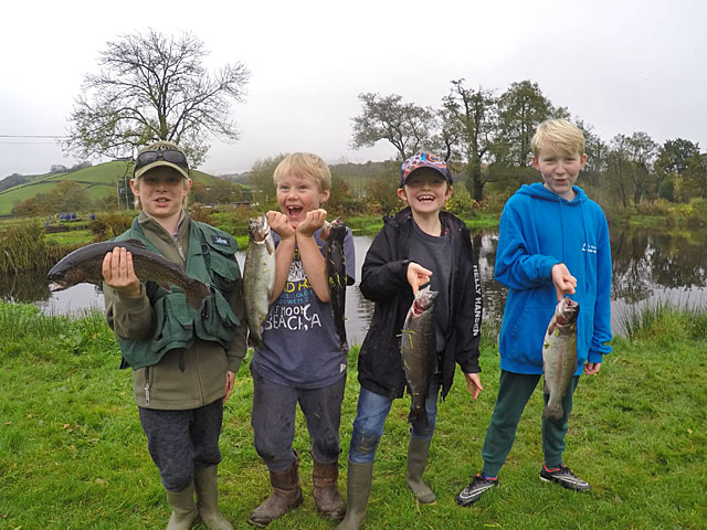 Four very happy boys enjoy there school holiday with a visit to Lobbs Lake at Exe Valley Fishery