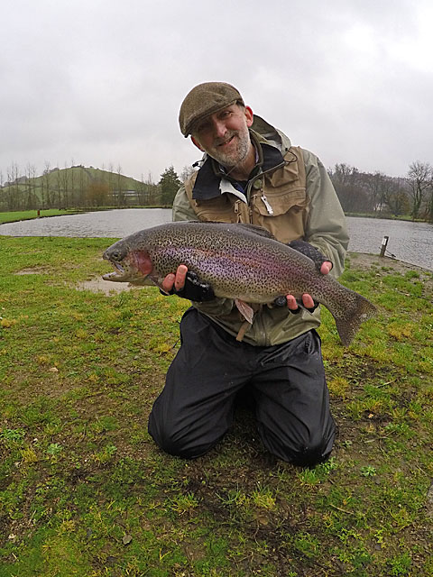 Patrick Silk with a 7lb Rainbow landed on a 6 weight rod