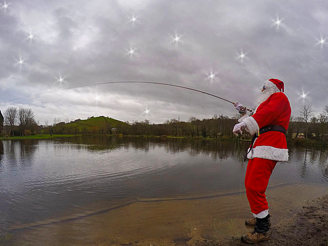 "Mr Claus protested that this picture proves he hooked a Trout during his most recent visit, but with no ""grip & grin"" evidence we must conclude that he hooked Rudolf on the back cast!"