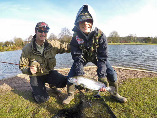 Proud Dad - Dean Mockridge with his son James and the Trout which helped him to win the 2016 Exe Valley Junior Troutmasters Fish Off
