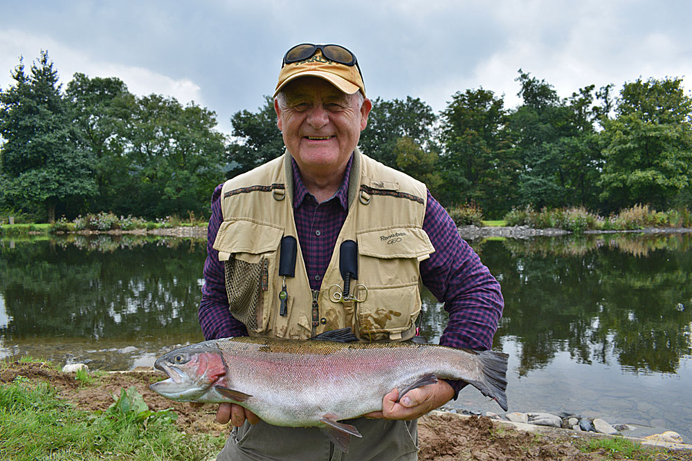 A very happy John Gilmore with one of the first double figure Trout following the reopening of Anchor Lake at Exe Valley Fishery.