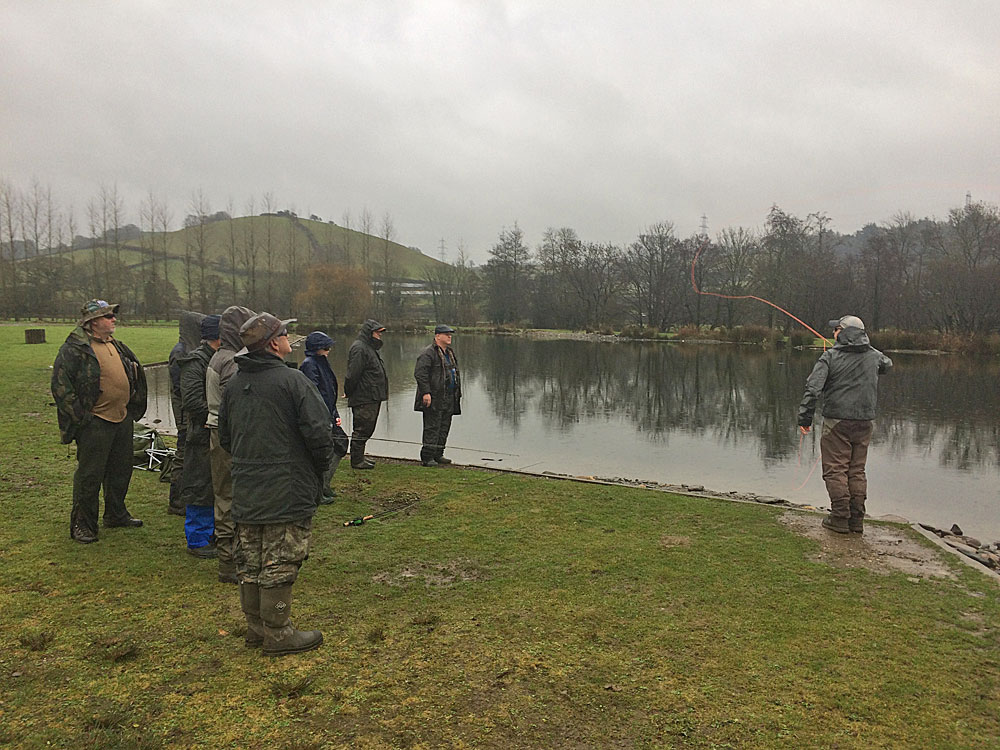 Anglers gather on the banks of Anchor Lake for one of the demos at the recent catch & release day at Exe Valley Fishery.