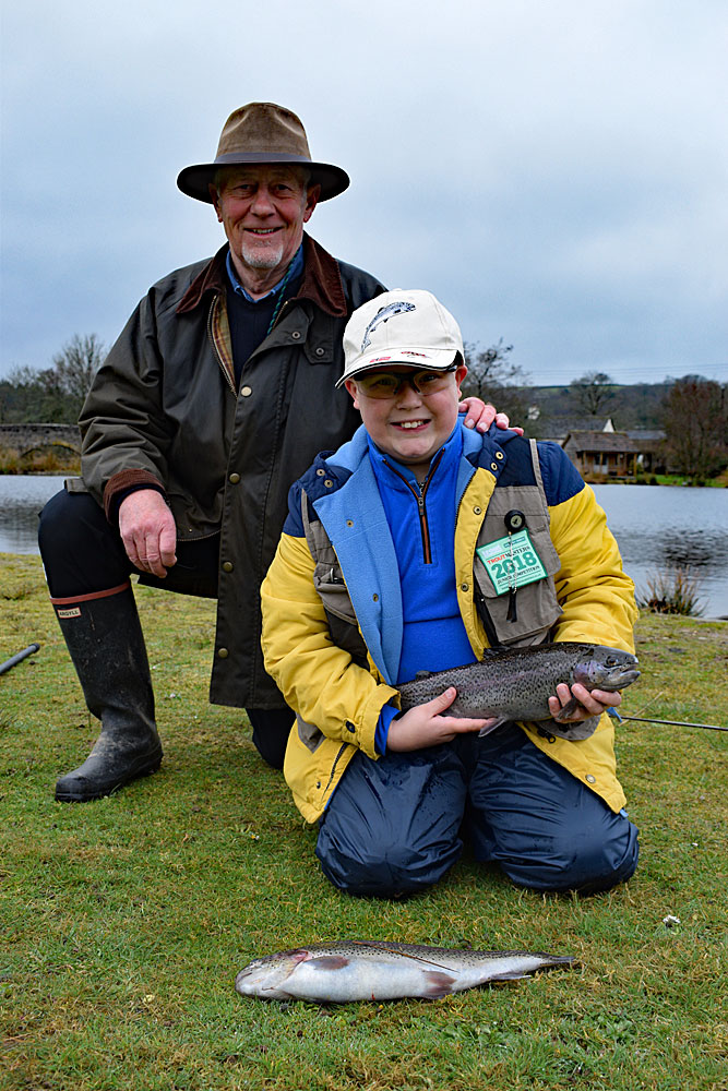 Sam with his first two fish, part of a four fish total which won him a place at the 2018 Junior Troutmasters final.