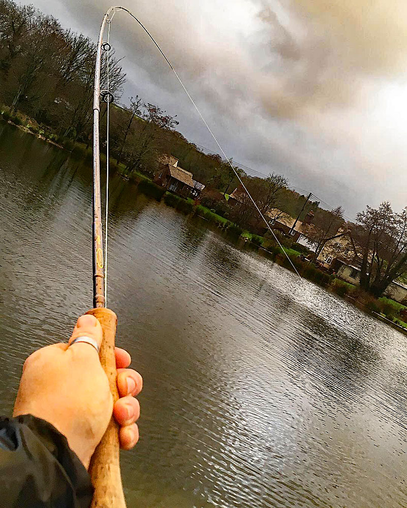Bad weather … what bad weather?! Blair gets his rod bent into the Anchor Lake trout on a grey Saturday before warming up with a post fishing burger & beer!