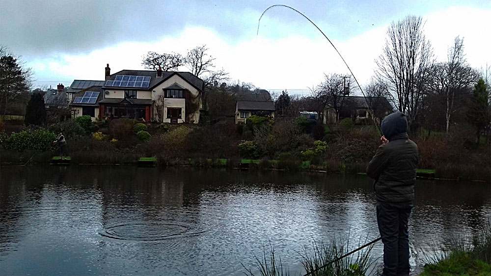 Ben Cheeld playing another Rainbow Trout on Anchor Lake……….