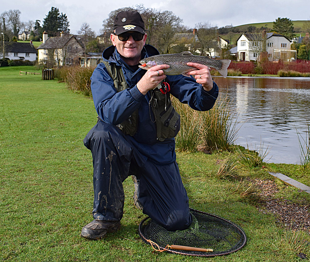 Chris Comber with his fin perfect Rainbow Trout caught on an Orange Blob