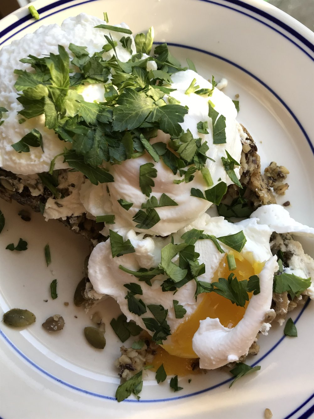 My homemade version of the Little Brother seeded loaf with goat cheese, poached eggs and parsley.