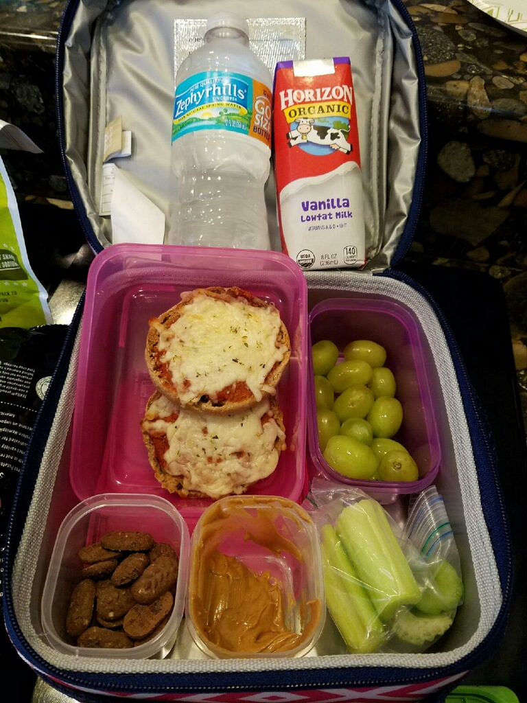 "Another perfectly balanced lunch box complete with whole grains, some protein, fruit, veggies, and healthy fats. Perfectly quoted by my client's mother ... ""Kid created, mom over-the-moon!"""