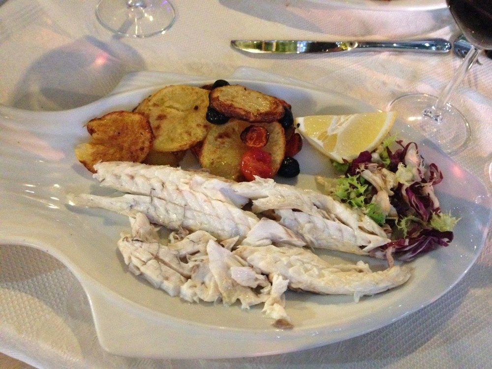 One of my favorite meals in Italy!! Fresh Catch of the Day with Potatoes and Roasted Red Peppers ... My husband and I shared a Caprese Salad and this dinner for two - it was healthy, delicious, and filling!