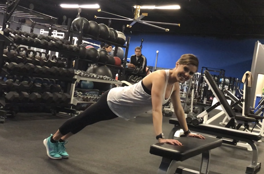 Modified push-ups on an exercise bench
