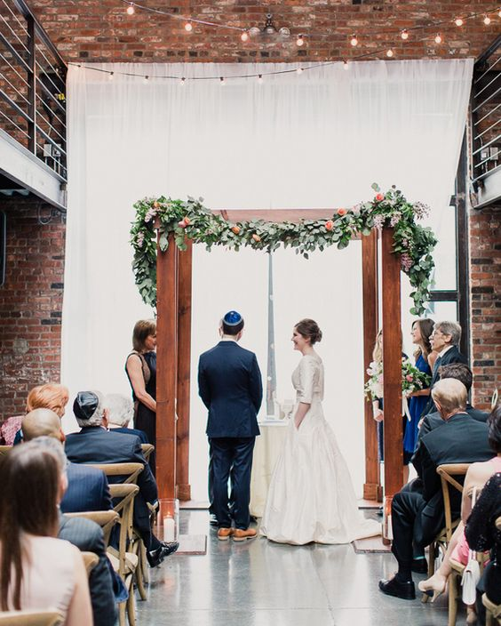 Simple, yet sweet rustic wood Chuppah via Martha Stewart Weddings