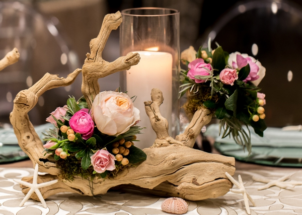 Gorgeous grapevine centerpiece dressed with flowers and shells for a fun yet pretty look.