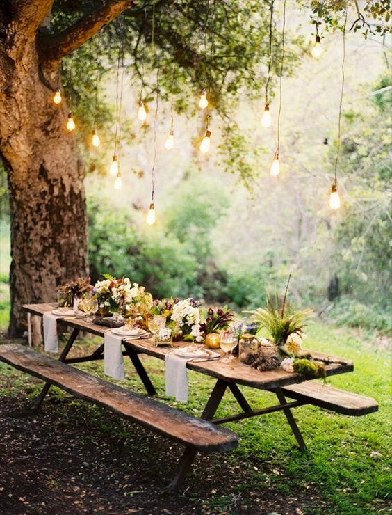 Dinner is served: it doesn't get prettier or cozier than a rustic, reclaimed wood farmhouse style table for an outdoor autumn wedding.