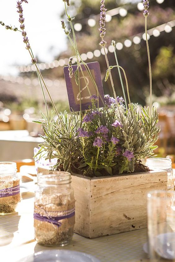 Want a South of France vibe? Try a lavender centerpiece with a reclaimed wood container.