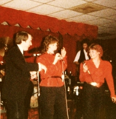 I love to sing and was the lead singer about a millennium ago for the Razazz Band.  That's me in the middle!  Okay, I'm a bit of a ham!