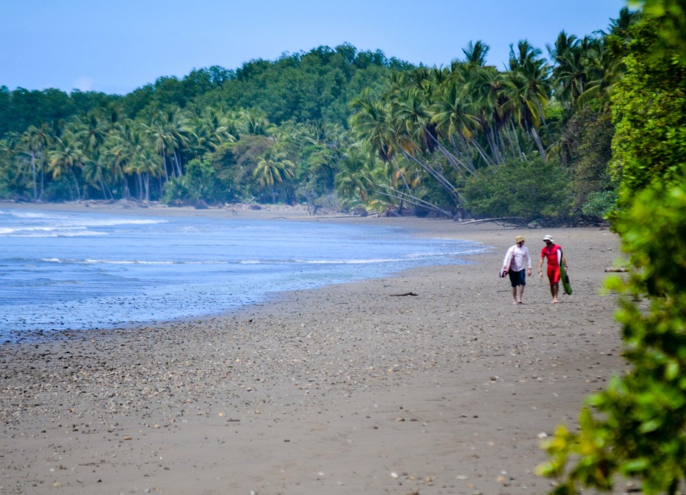 Strolling the undeveloped coastline of Marino Ballena National Park in Bahia Ballena, Costa Rica
