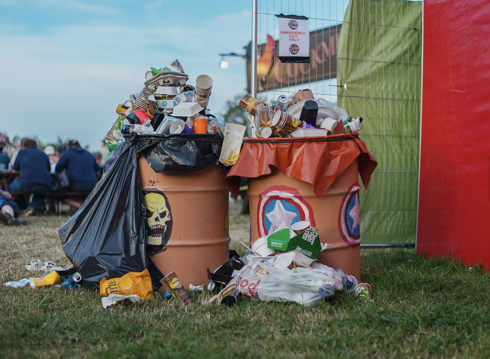Festivals are enormous nomadic tableaus of creative energy, and they are also islands of trash, mostly plastic. Photo: Glastonbury Music Festival throw-aways by Andy Hughes