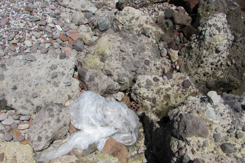 Plastic pollution camouflaged (almost) by rocks
