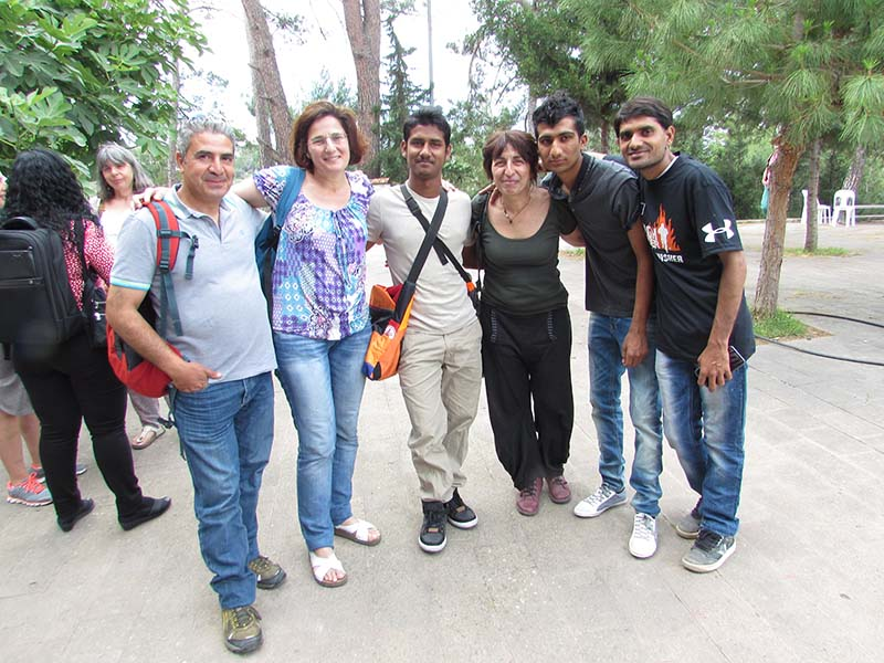 Refugees from Syria and Pakistan, with volunteer supporters (Lena Altinoglou is third from right).