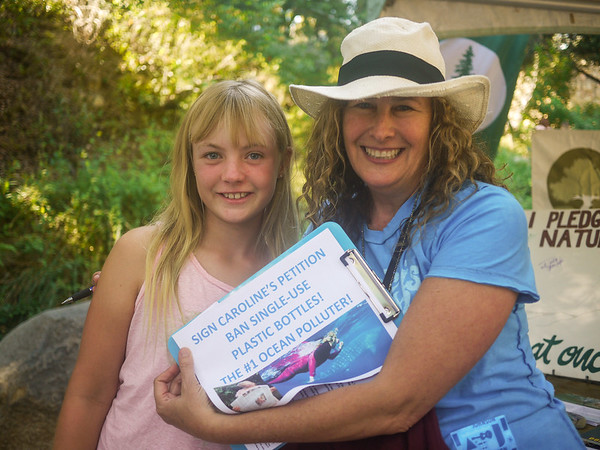 Dianna Cohen signs the petition from PPC youth ambassador Caroline to ban single-use plastic bottles in Santa Barbara County.Photo by Brandise Danesewich @antimodel