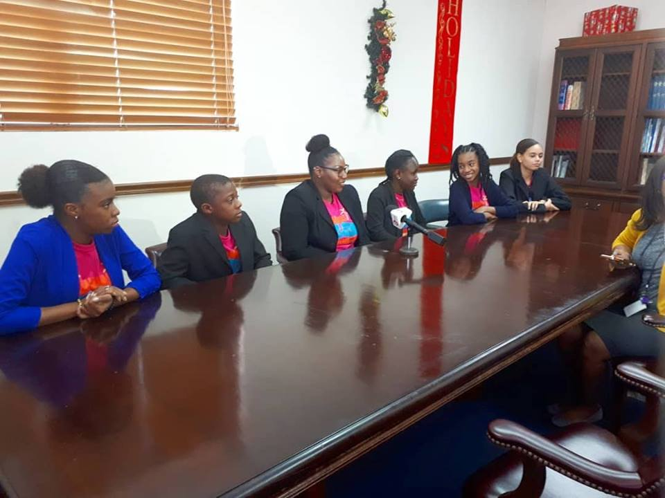 The youth delegation gives news interviews after speaking with the Minister.