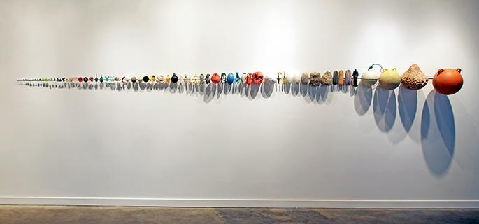 Pam Longobardi ,  Economies of Scale,  2013, microplastic, plastic, hydrocarbons, and steel, 24 x 208 x 30 inches. Courtesy of the artist and Hathaway Contemporary. Photo credit: Mike Jensen.