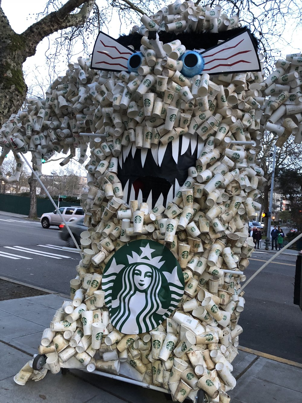 Activists used 8,000 cups to create the cup monster, the same amount Starbucks serves every minute.