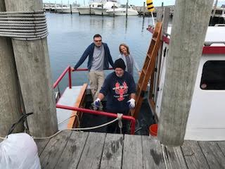 Fisherman Eric DeWitt, art teacher Melissa Knowles, and filmmaker Rob Barracano venture out in Eric DeWitt's boat to collect plastic from the sea in Martha's Vineyard.