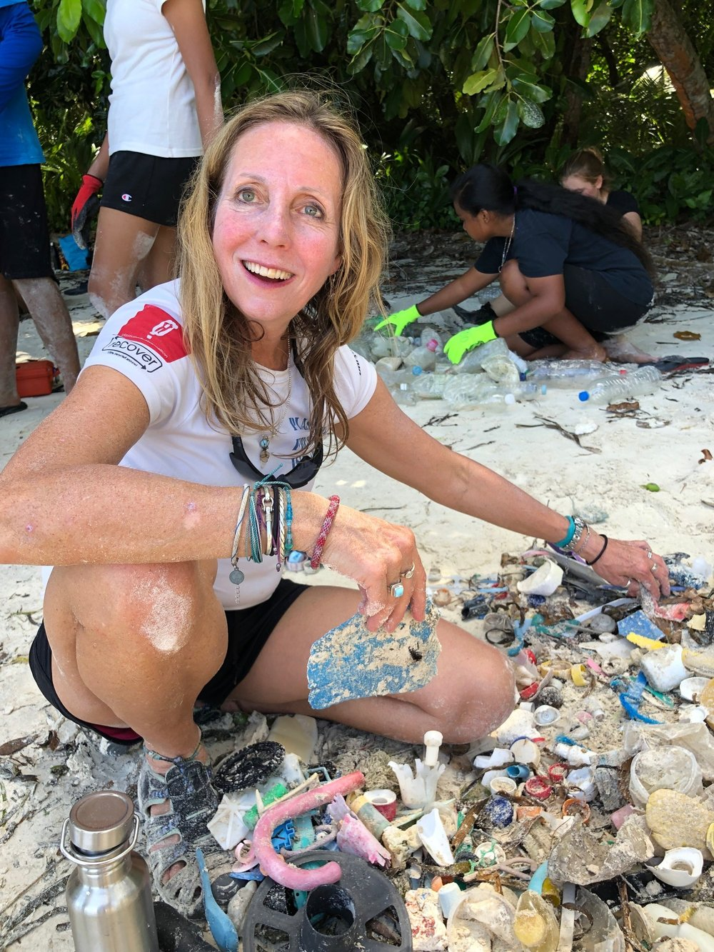 Pamela Longobardi of Drifter's Project and a PPC Supporting Artist Ally collects beach plastic during the clean up and brand audit. Photo by Wayne Sentman.