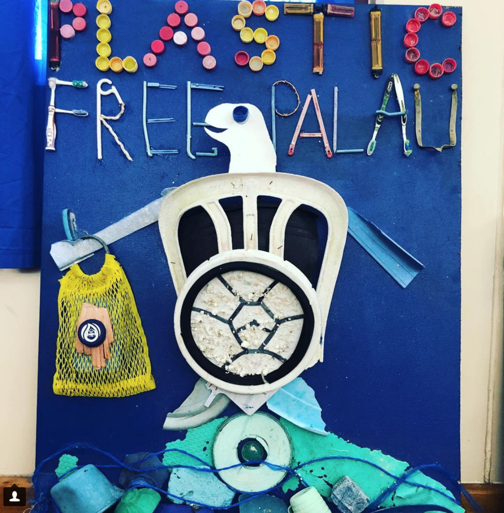 Plastic Free Palau sign made by students from plastic collected from the beach. Photo by Dianna Cohen.