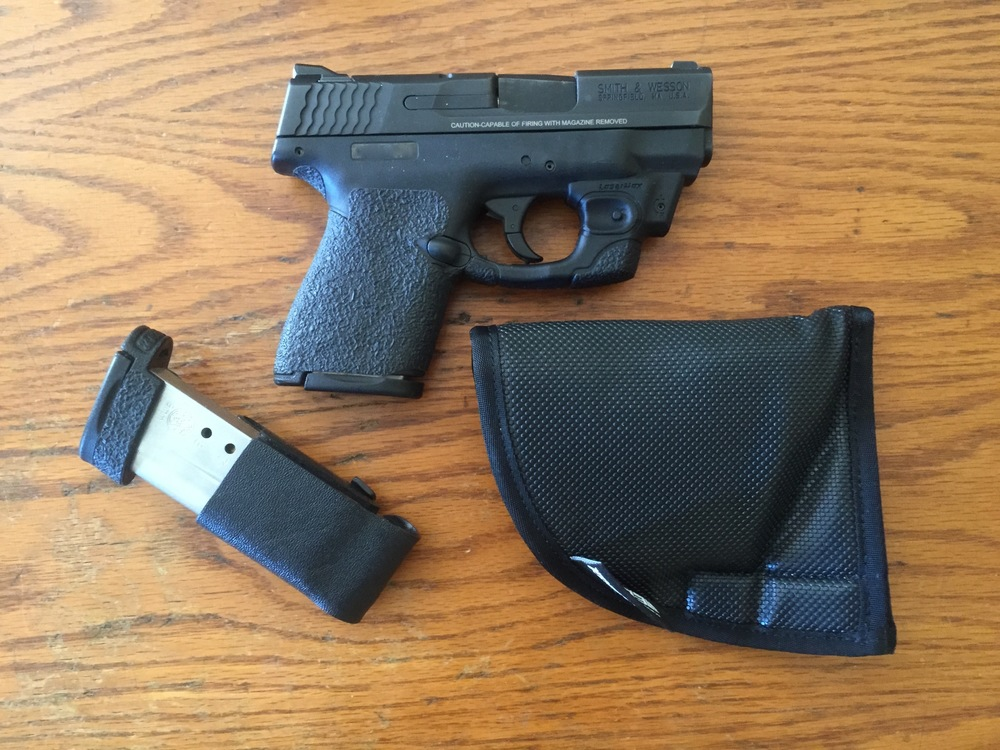 Concealed under the shirt: M&P Shield with LaserMax, mag in Kytex holder and the holster
