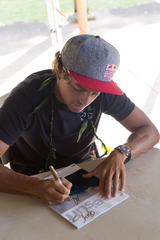 Kai Lenny signing autographs.