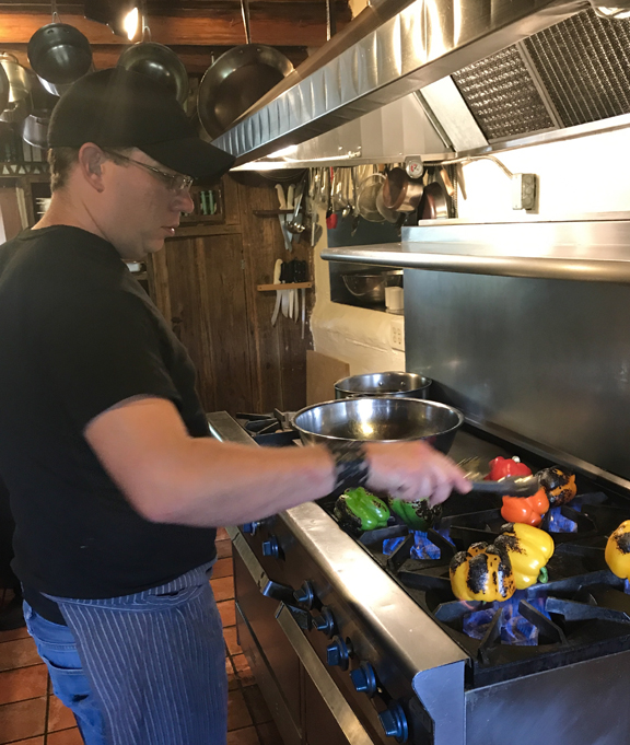 Roasting peppers in kitchen at Mabel Dodge Luhan
